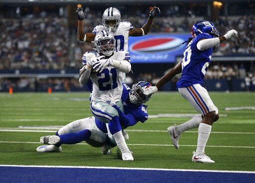 (AP Photo/Ron Jenkins). Dallas Cowboys running back Ezekiel Elliott (21) runs the ball for a touchdown after getting past New York Giants outside linebacker Alec Ogletree, center bottom, and Janoris Jenkins, right, as wide receiver Tavon Austin, rear, ...
