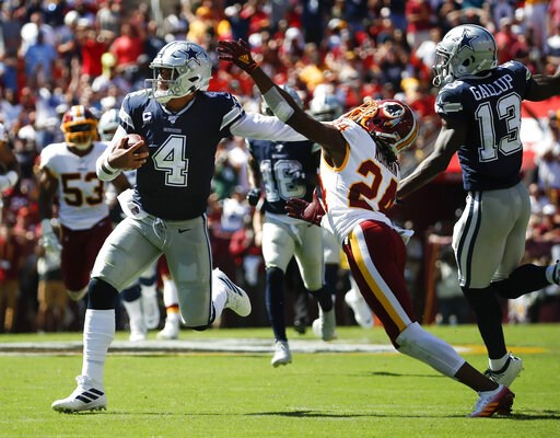 (AP Photo/Alex Brandon). Dallas Cowboys quarterback Dak Prescott (4) breaks away from Washington Redskins cornerback Josh Norman (24) to run downfield in the first half of an NFL football game, Sunday, Sept. 15, 2019, in Landover, Md. Also on the field...