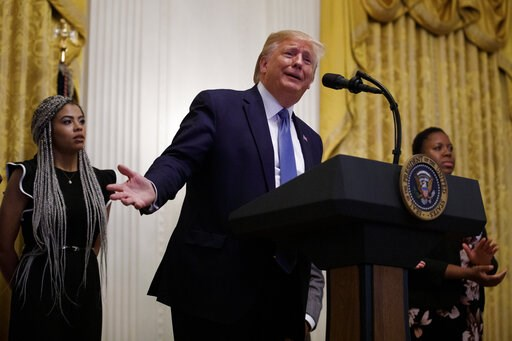 (AP Photo/Carolyn Kaster). President Donald Trump speaks during the Young Black Leadership Summit at the White House in Washington, Friday, Oct. 4, 2019. At left is Kearyn Bolin, President of TPUSA at Texas State University.
