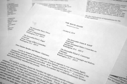 """(AP Photo/Jon Elswick). A letter from White House counsel Pat Cipollone is photographed in Washington, on Tuesday, Oct. 8, 2019. The White House declared it will not cooperate with what it termed the """"illegitimate"""" impeachment probe by House Democrats,..."""