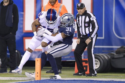 (AP Photo/Bill Kostroun). New York Giants wide receiver Golden Tate (15) comes down with a catch just in front of the goal line against Dallas Cowboys cornerback Byron Jones (31) during the second quarter of an NFL football game, Monday, Nov. 4, 2019, ...
