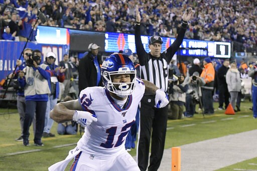 (AP Photo/Bill Kostroun). New York Giants wide receiver Cody Latimer (12) celebrates after scoring a touchdown against the Dallas Cowboys during the second quarter of an NFL football game, Monday, Nov. 4, 2019, in East Rutherford, N.J.