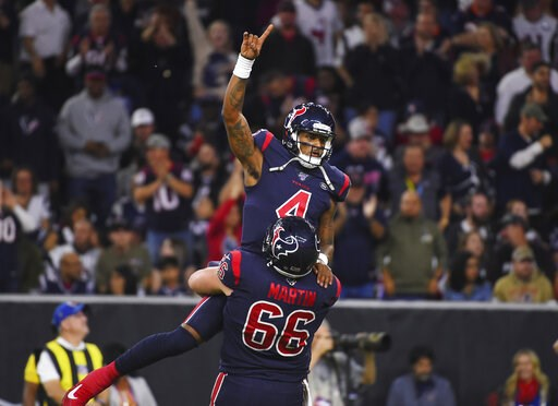 (AP Photo/Eric Christian Smith). Houston Texans quarterback Deshaun Watson (4) is lifted by center Nick Martin (66) as they celebrate a touchdown against the New England Patriots during the first half of an NFL football game Sunday, Dec. 1, 2019, in Ho...