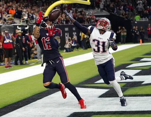 (AP Photo/David J. Phillip). Houston Texans wide receiver Kenny Stills (12) pulls in a pass in front of New England Patriots cornerback Jonathan Jones (31) for a touchdown during the second half of an NFL football game Sunday, Dec. 1, 2019, in Houston.