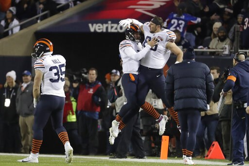 (AP Photo/Morry Gash). Chicago Bears quarterback Mitchell Trubisky (10) celebrates with Bradley Sowell (85) after Trubisky threw a touchdown pass during the first half of an NFL football game against the Dallas Cowboys, Thursday, Dec. 5, 2019, in Chica...