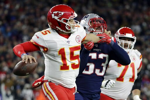 (AP Photo/Elise Amendola). Kansas City Chiefs quarterback Patrick Mahomes grabs the face mask of New England Patriots linebacker Kyle Van Noy, right, as he rolls out to pass in the second half of an NFL football game, Sunday, Dec. 8, 2019, in Foxboroug...