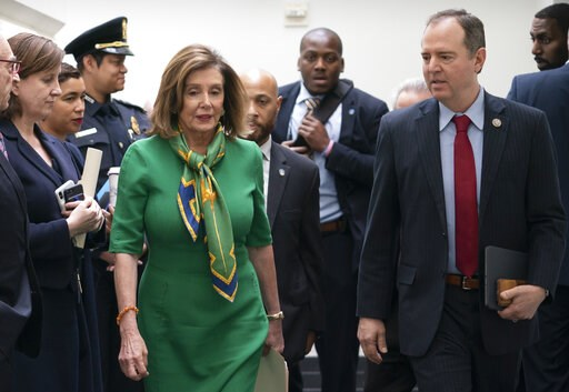 (AP Photo/J. Scott Applewhite). Speaker of the House Nancy Pelosi, D-Calif., joined by House Intelligence Committee Chairman Adam Schiff, D-Calif., leaves a lengthy closed-door meeting with the Democratic Caucus at the Capitol in Washington, Tuesday, J...