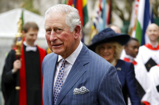 (AP Photo/Kirsty Wigglesworth, File). FILE - In this Monday, March 9, 2020 file photo, Britain's Prince Charles and Camilla the Duchess of Cornwall, in the background, leave after attending the annual Commonwealth Day service at Westminster Abbey in Lo...
